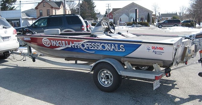 Signs Now Hanover designed, printed and installed this boat wrap for Reservoir Boat Works custom all electric boat.