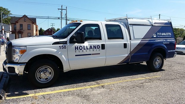 Signs Now Hanover has designed and installed a number of partial vehicle wraps for Holland Electric.